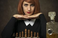 Portrait of a girl with a chess